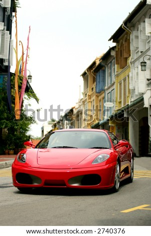 Red Ferrari F430 in Chinatown of Singapore - stock photo