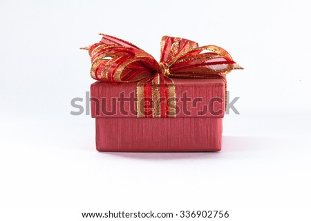 Red festive gift box with red ribbon and bow