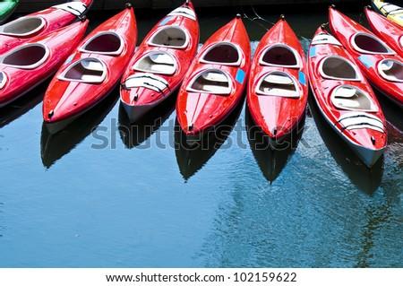 Red fiberglass kayaks - stock photo