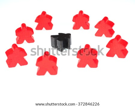 red figures surround a black figure on white - stock photo