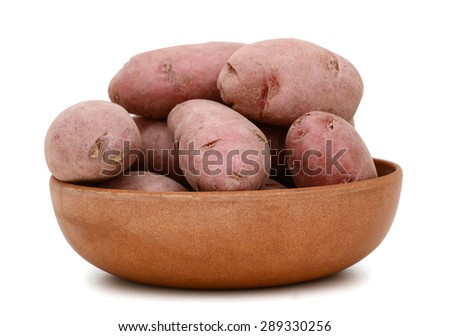 red fingerling potatoes in bowl isolated on white  - stock photo