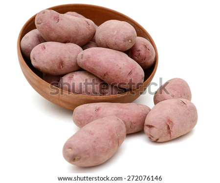red fingerling potatoes in bowl on white background  - stock photo