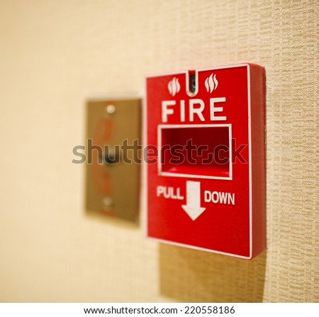 Red fire alarm box on the wall