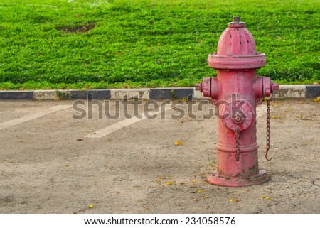 red fire hose valve side street in garden - stock photo