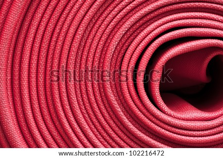 Red fire hose winder - stock photo