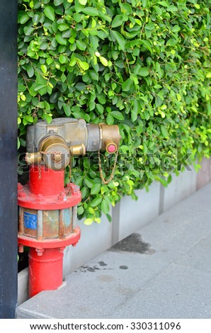 Red Fire pumps, Fire Department Connector, Fire hydrant, Hose Connection, Fire Fighting Equipment for fire fighter on the street - stock photo