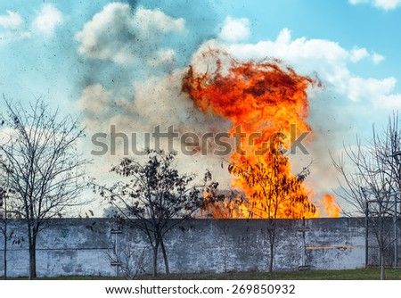red fire with smog under clouds - stock photo