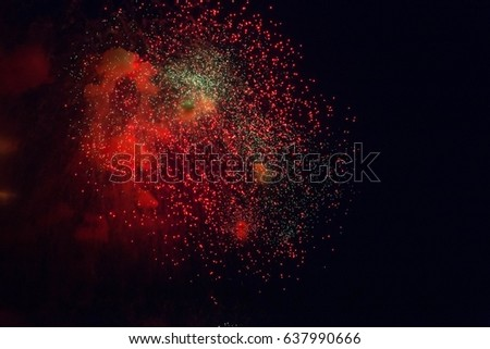 Red fireworks at night