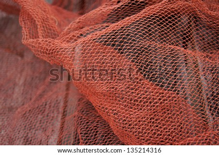 Red fishnet - stock photo