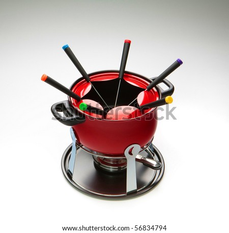 red fondue set on gradient background - stock photo