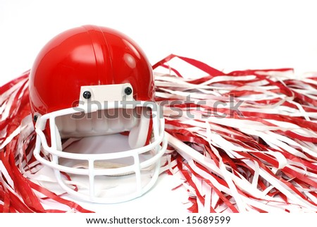 Red football helmet and pom poms isolated on white background. - stock photo
