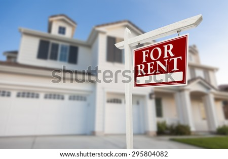 Red For Rent Real Estate Sign in Front of Beautiful House. - stock photo