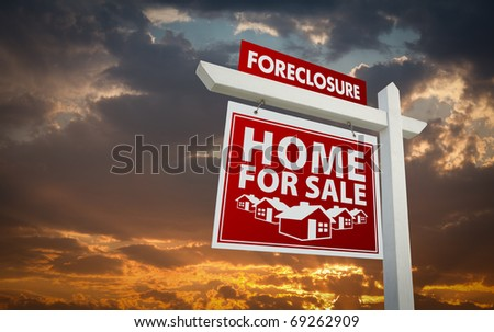 Red Foreclosure Home For Sale Real Estate Sign Over Beautiful Clouds and Sunset Sky. - stock photo