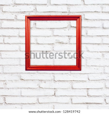 red frame on white brick wall - stock photo