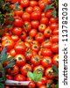 Red fresh tomatoes at market place - stock photo