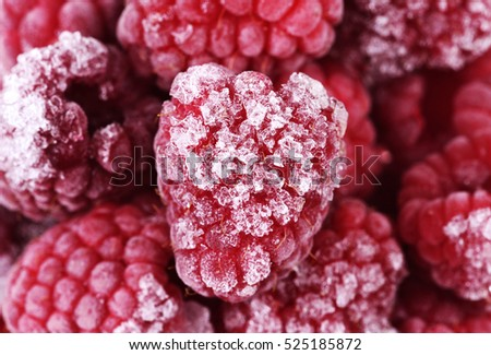 Red frozen raspberries background close-up photo