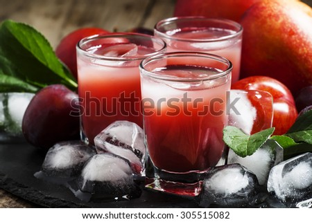 Red fruit cocktail with ice, selective focus - stock photo