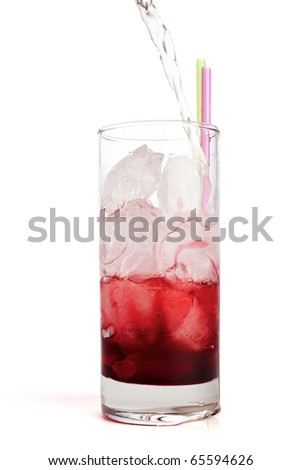 Red fruit juice on ice cubes poured with cold water - stock photo