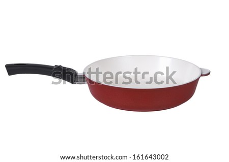 Red frying pan with a ceramic covering isolated on a white background. - stock photo