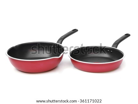 red frying pans                                - stock photo