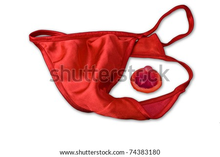 Red g-string panties and a red condom on a white background. Safe sex message.