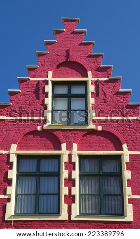 Red gable roof of the historic house (Bruges, Belgium). Front view. - stock photo