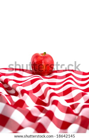 Red Gala Apple on Checkered Tablecloth on White Background - stock photo