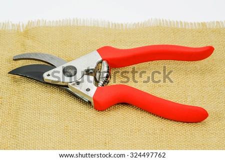 Red garden secateurs - stock photo