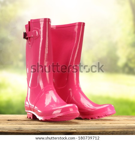 red garden shoes  - stock photo