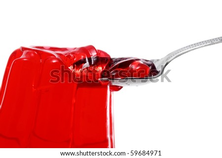 red gelatin with a spoon isolated on a white background - stock photo