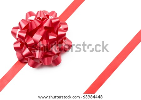 Red gift bow and ribbon isolated on white. - stock photo