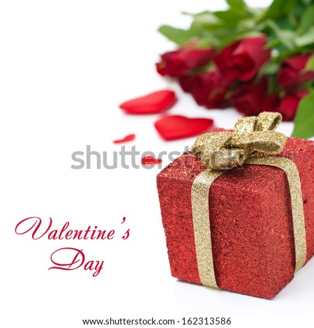 red gift box and roses in the background, isolated on white