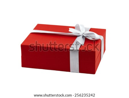 Red gift box decorated white ribbon with bow isolated on white background - stock photo