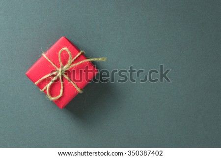 Red gift box on grey background, with copy space - stock photo