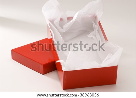 Red gift box on white background. Isolated. Open. - stock photo
