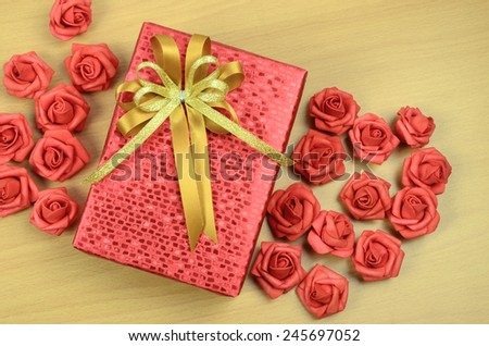 red gift box on wood background