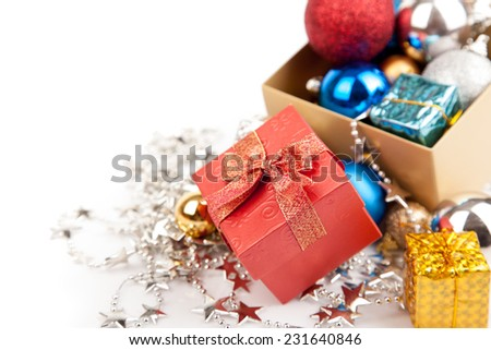 Red gift box with christmas tree bauble and ornament  on white background