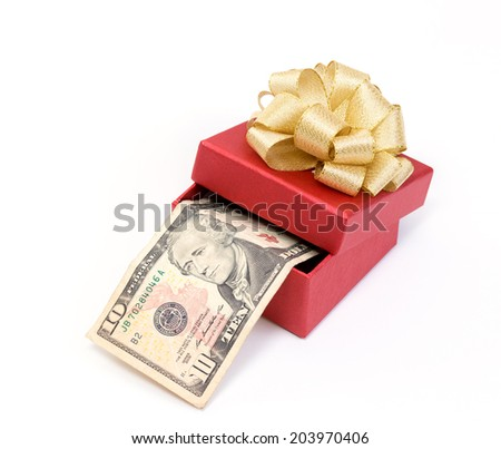 Red gift box with dollar bills on white background - stock photo