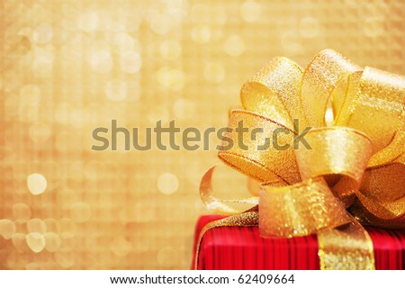 Red Gift box with gold ribbon - stock photo