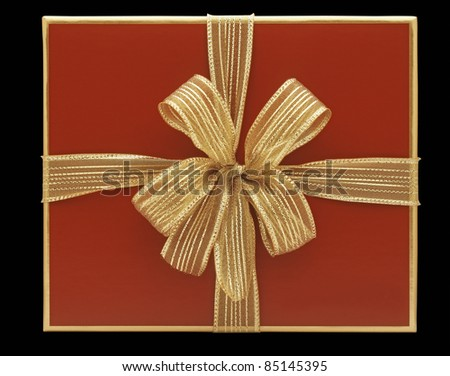 Red gift box with golden node - stock photo