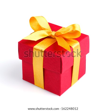 red gift box with golden ribbon and bow isolated on white