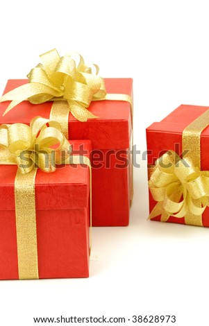 Red gift box with golden ribbon isolated on the white background