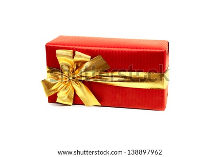 Red gift box with golden ribbon isolated, over white background