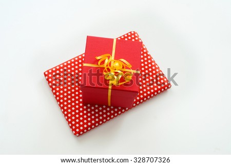 Red gift box with ribbon isolated on white background.  - stock photo