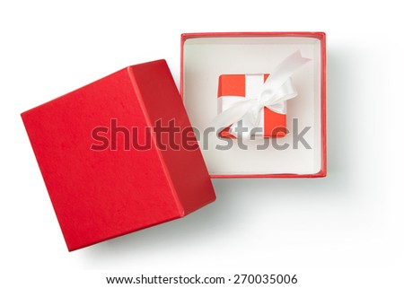 Red gift box with ribbon on white background - stock photo