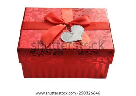 Red gift box with satin ribbon bow and hart shape card isolated - stock photo