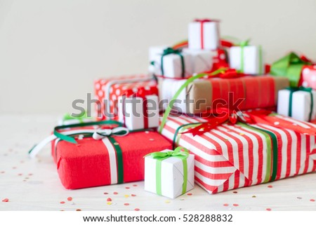 Red gift boxes with colorful ribbons. White background. Gifts for Christmas.
