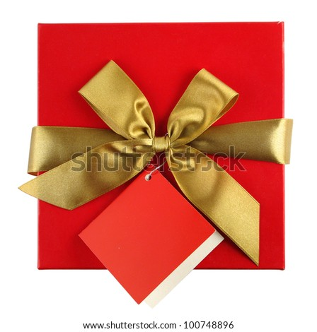 Red gift with golden ribbon and blank note - stock photo