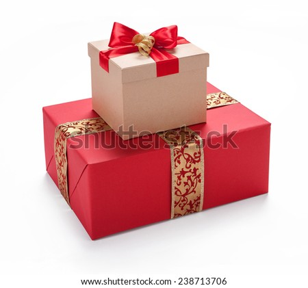 Red giftbox. Merry Christmas & New Year's Eve concept / studio photography of red and white box wrapping ribbon with bowknot - on white background  - stock photo