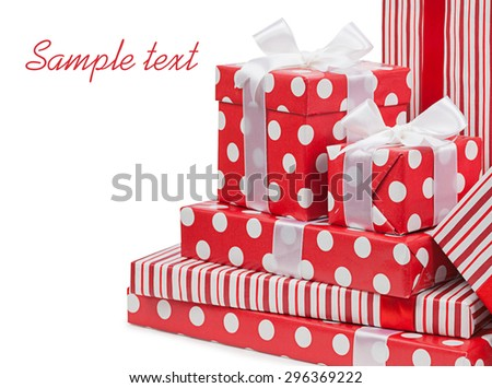 Red gifts boxes gifts tied with white bows ribbon isolated. - stock photo